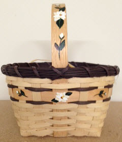 Magnolia basket 9 dia x 9 1/2 include handle  hand painted magnolia on handle and around basket $35