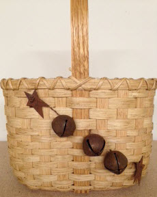 Jingle bell basket   Oval basket 10 x 6 1/2 x 13 with handle. Rusty bell accents $35. Oak base and handle