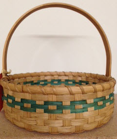 "Easter basket 10"" dia 10"" high with handle handed painted handle. Green accent. Reg $45.  SALE $35"