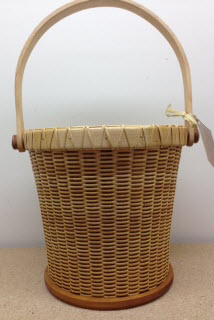 "9 1/2"" Nantucket beer bucket. Cherry base Maple rim and handle. With metal lined will hold six long neck bottles"