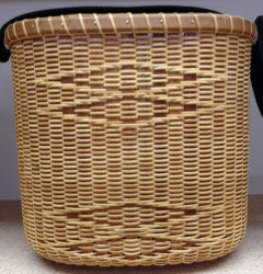 Nantucket double wine tote with basket embroidered strap. Cherry stave rim and base. Double diamond accent 9 x 5 1/2 x 8 1/2.