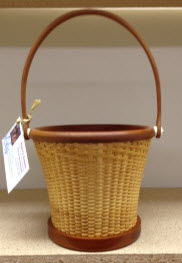 "6"" Nantucket flower pot. 6 1/2 dia 6"" tall. Cane on cane. Cherry rim base and handle trill boarder"