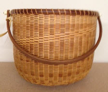 "10"" traditional Nantucket. Walnut staves rim base and handle tripe step in weaving $350"